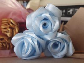 Handmade silk roses on birchwood