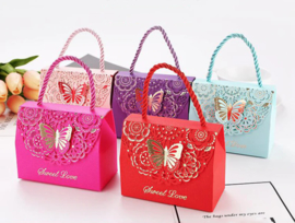 Premium luxury giftbags with laser-cut gold foil butterfly motif and rope hanger