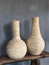 Vaas van palmbladeren
