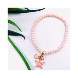 Roze zeester 'goudkleur'