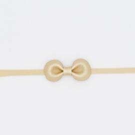 Noah & Sisi - Haarbandje met kunstleer strikje - goud