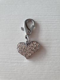 Stekemarkeerder hart met steenjes
