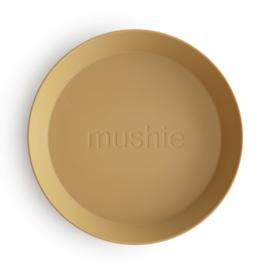 Mushie plates - round Mustard