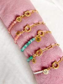 Armbandje turquoise schakels goud
