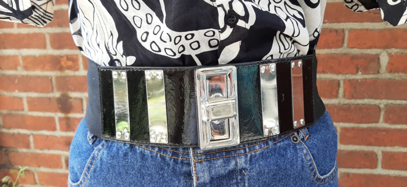 Belt with stretch band and silver clasp