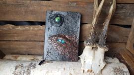 Notitieblok A6 donkerbruin / koper draak met blauw oog