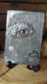 Notitieblok A6 zilveren draak met roze oog
