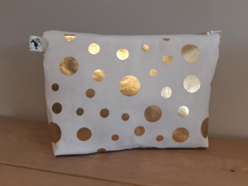 Toilettas golden dots