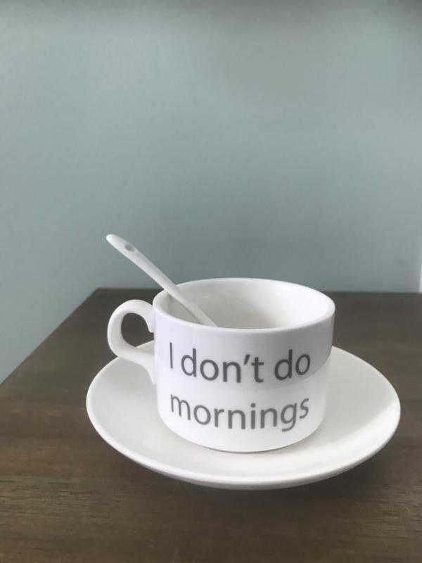 Koffietas met schotel en lepel