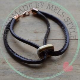 Lederen armband met keramiek kraal goudkleur & wit