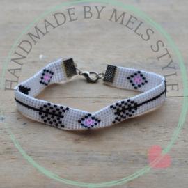 Geweven armband zwart wit roze