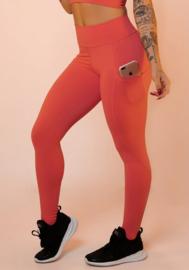 Koraalkleurige leggingbroek met basiszak