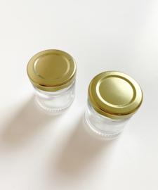 Glazen honingpotjes