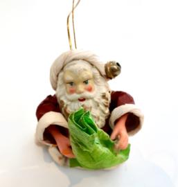 Prachtige kerstman met feather tree en kerstboek
