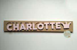 Naampuzzel 9-11 letters. Bijv. 'Charlotte - zacht roze'