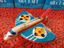 seventies tin-toy airplaine with origional packaging.