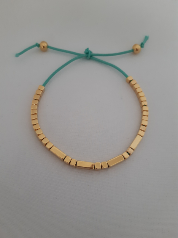 Goudkleurige tube armband