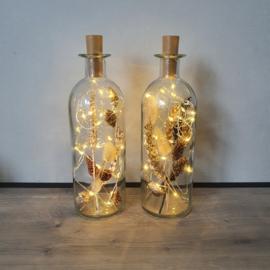 Fles droogbloemen rond met LED