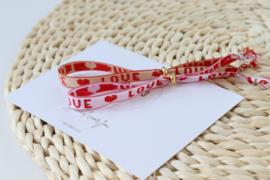 Armbandje LOVE - rood / wit