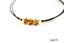 Armband zwart met goudkleurige hematiet sterretjes
