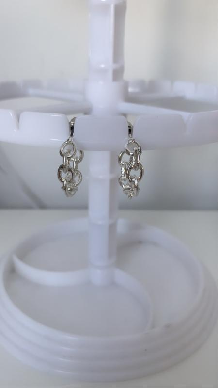 Zilveren oorbellen schakel