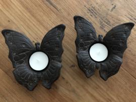 Zwart zwaar metalen waxinelichthouder in de vorm van een vlinder