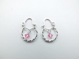 Zilveren baby oorbellen roze kraal.