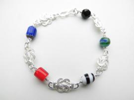 Zilveren mattenklopper allakondre kralen bracelet.