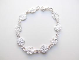 Zilveren piet-piet /mattenklopper bracelet. (dik)