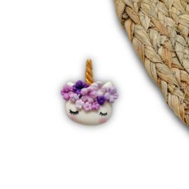 Eenhoorn hoofdje paars