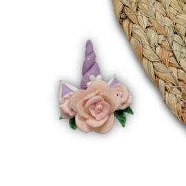 Eenhoorn paars roosjes