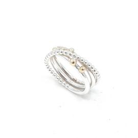 Zilveren ring met geelgouden ballen.