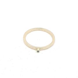 Geelgouden ring met blauw topaas.