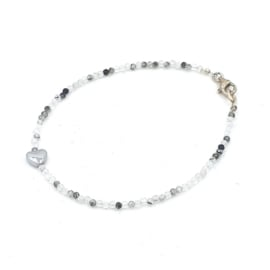 Zilveren geregen armband met rutielkwarts.