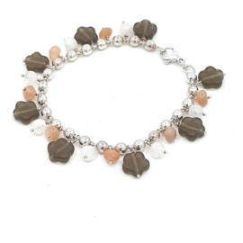Zilveren ballen armband met romijns glas.