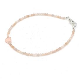 Zilveren geregen armband met goud rutielkwarts.