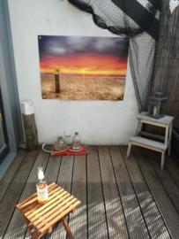 Tuinposter, strandpaal en zonsondergang.