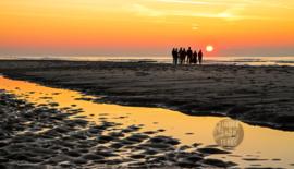 Zonsondergang op Texel, ringen in de hoeken.