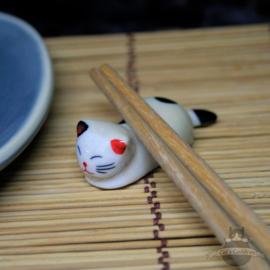 Eetstokjes steun rustende kat crèmekleur