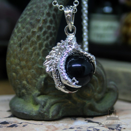 Dragonclaw necklace holding a black Agate