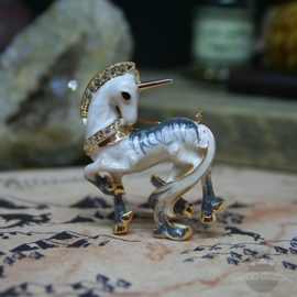 Enamel unicorn brooch inlayed with stones