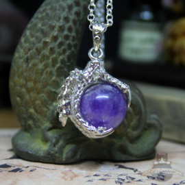Dragonclaw necklace holding an Amethyst
