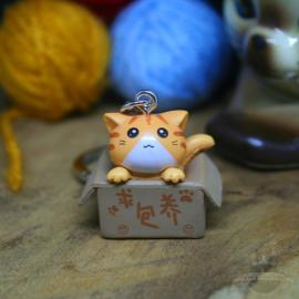 Schlüsselanhänger Adoption orange Katze in Box