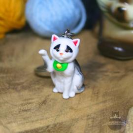 Schlüsselanhänger Katze mit erhobener Pfote