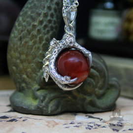 Dragonclaw necklace holding a red Agate