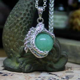 Dragonclaw necklace holding an Aventurine