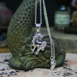Small unicorn necklace silver colored