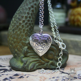 Heart shaped locket with cat pawprint silver colored