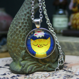 Yellow cartoon cat in round pendant necklace