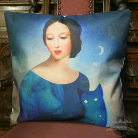Woman together with a blue starry cat pillowcase